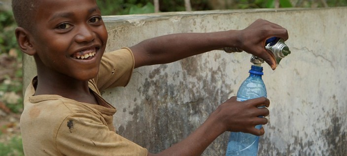 150109175119-haiti-hero-josue-lajeunesse-clean-water-kid-bottle-full-169